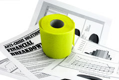 Toilet paper upon newspaper article about crisis Royalty Free Stock Image