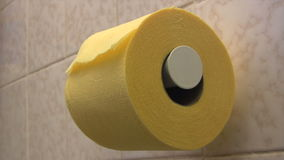 Toilet Paper. Person using lots of yellow toilet paper in a rest room. Canon HV30. HD 16:9 1920 x 1080 at 25.00 fps. Progressive scan. Photo JPG Compression. No stock video footage