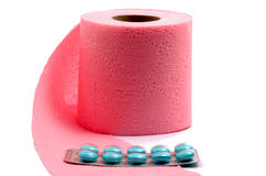 Toilet paper and pills. On white backgroud, isolated Royalty Free Stock Image