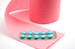 Toilet paper and pills Stock Images
