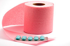 Toilet paper and pills. On white backgroud, isolated Royalty Free Stock Images