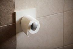 Toilet paper roll in bathroom Royalty Free Stock Photography