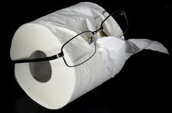 Toilet paper roll with glasses Stock Photography