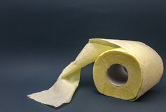 Toilet paper roll grey yellow wc close-up stock photo