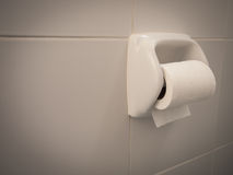 Toilet paper  roll. Hanging on the wall Royalty Free Stock Photos