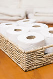 Toilet paper rolls basket Stock Photography