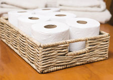 Toilet paper rolls on basket Royalty Free Stock Images
