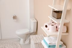 Toilet paper rolls on shelving unit in bathroom stock photos