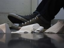 Toilet Paper and Shoes on the Floor stock photo