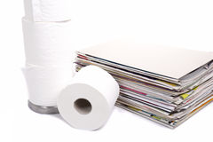 Toilet paper and stack of magazines Stock Photo