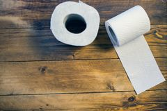 Toilet paper on wood background.  Royalty Free Stock Photo