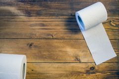 Toilet paper on wood background.  Stock Images