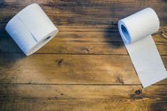 Toilet paper on wood background.  Royalty Free Stock Photography