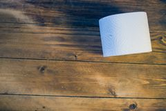 Toilet paper on wood background.  Royalty Free Stock Image