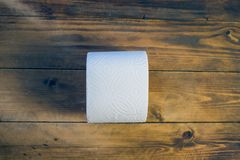 Toilet paper on wood background.  Royalty Free Stock Photos