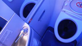Toilet in the plane. Airplane bathroom stock footage