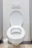 Toilet. A toilet is a plumbing fixture used for defecation and urination. Modern toilets consist of a bowl fitted with a hinged seat and are connected to a waste Stock Images