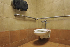 Toilet in a public restroom stall Royalty Free Stock Images