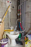 Toilet during renovation. Bathroom under construction: old toilet during renovation royalty free stock photos