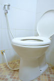 Toilet room corner with open seat cover Stock Image