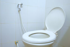 Toilet room corner with open seat cover Royalty Free Stock Image