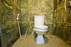 Toilet. Room with decorate walls Stock Photography