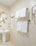 Toilet room interior. Wash-room interior with white ceramics Royalty Free Stock Photo