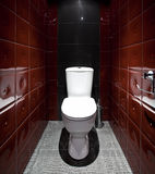 Toilet room in red colors Stock Photo