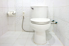 Toilet seat in bathroom Royalty Free Stock Photography