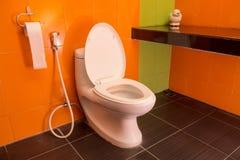 Toilet seat decoration in bathroom interior Royalty Free Stock Photo