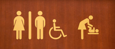 Toilet Sign. A toilet sign with wooden background royalty free stock image