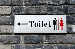 Toilet Sign. Mounted on a brick wall Stock Image
