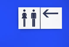 Toilet sign. With blue background Royalty Free Stock Photos