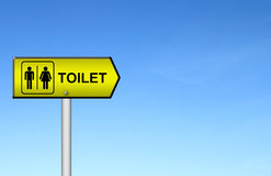 Toilet sign with blue sky Stock Images