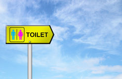 Toilet sign with blue sky Royalty Free Stock Image