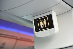Toilet sign in a Boeing 787 Dreamliner at Singapore Airshow 2012 Royalty Free Stock Photos