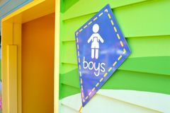 Toilet sign for boys in the shape of a kite. At the entrance to a public toilet royalty free stock image