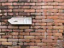 Toilet sign. On brick wall Royalty Free Stock Photo