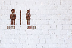 Toilet sign on brick wall. Royalty Free Stock Images