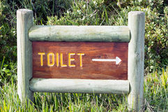 Toilet sign in the bush Royalty Free Stock Photo