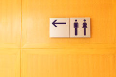 Toilet sign and direction. To the restroom Stock Images