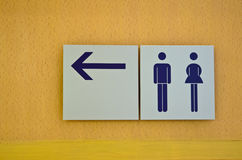 Toilet sign. And direction on wooden background Stock Image