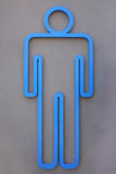 Toilet sign with grey wall Royalty Free Stock Photography