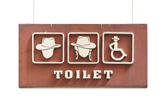 Toilet sign hanging on wall Stock Image