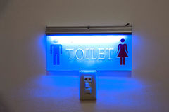 Toilet sign with lighting. Stock Images