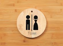 Toilet sign of male and female on natural wood for restroom with hardwood door panel background royalty free stock photo