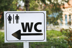 Toilet sign for man and female on white table in nature Stock Image