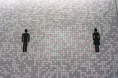 Toilet sign on mosaic wall Royalty Free Stock Images