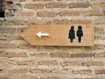 Toilet sign. On plain brick wall Stock Photography