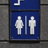 Toilet sign on wall at public street Royalty Free Stock Photos